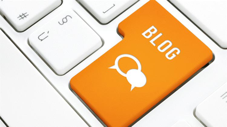 keyboard with orange enter button labelled blog