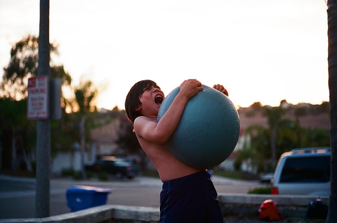 boy squeezing a exercise ball