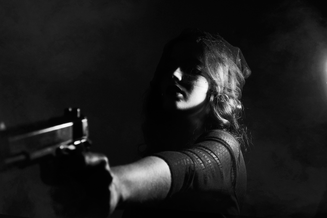 lady pointing gun
