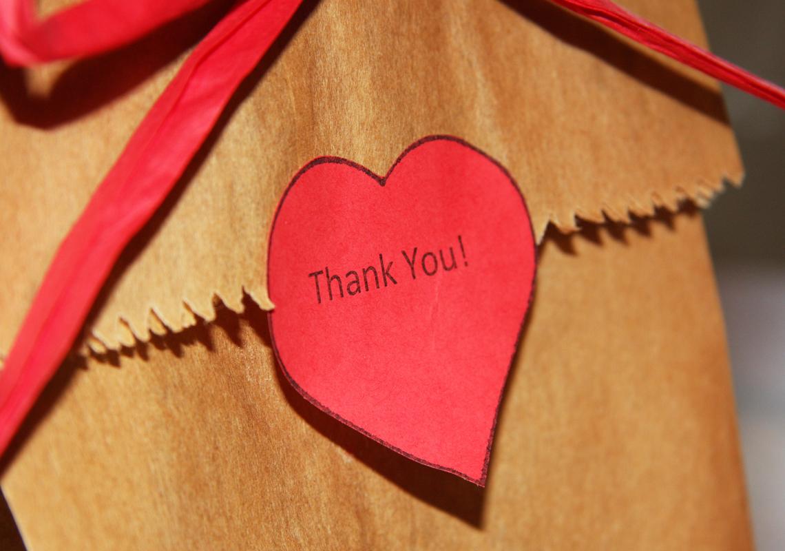 thank you written on paper heart